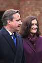 Britain's Prime Minister David Cameron and his Secretary of State for Northern Ireland Theresa Villiers speak to the waiting media at Stormont House for day one of a cross-party talks at Stormont House in Belfast, Northern Ireland, Thursday Dec 11, 2014. David Cameron and the Irish Prime Minister Enda Kenny are hoping to secure agreement in the talks concerning disputes on flags, parades, the past and welfare reform. Photo/Paul McErlane