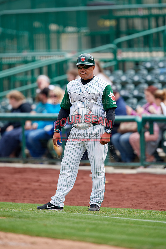 Fort Wayne TinCaps coach Jhonny Carvajal (7) during a game against the Wisconsin Timber Rattlers on May 10, 2017 at Parkview Field in Fort Wayne, Indiana.  Fort Wayne defeated Wisconsin 3-2.  (Mike Janes/Four Seam Images)