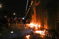 Protesters set on fire a door at the National Palace in Mexico City.  In support of the 43 student teachers who presumably were killed and incinerated in the state of Guerrero, 11/8/2014 VIEWpress / Miguel Angel Pantaleon