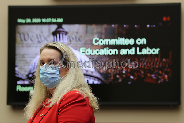Occupational Safety and Health Administration Principal Deputy Assistant Secretary Loren Sweatt prepares to testify about the federal government's role in protecting workers during the novel coronavirus pandemic before the United States House Education and Labor Committee on Capitol Hill May 28, 2020 in Washington, DC. More than 62,000 health care workers have been infected with COVID-19 and close to 300 have died according to the U.S. Centers for Disease Control. <br /> Credit: Chip Somodevilla / Pool via CNP/AdMedia