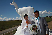 A couple marries in front of the mascot of Kyzyl, capital of Tuva Republic, southern Siberia, Russia