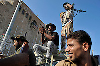 Men celebrate as they sit on a barricade at Marytrs' Square in Tripoli. After a six month revolution, rebel forces finally managed to break into Tripoli and have taken control of Bab al-Aziziyah, Col Gaddafi's compound and residence. Few remain that are loyal to Gaddafi in the city; it is seeming that the 42 year regime has come to an end. Gaddafi is currently on the run.