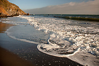 Pacific Ocean waves flow onto the shore at Stinson Beach in Marin County, California
