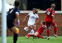 WINSTON-SALEM, NORTH CAROLINA - September 01, 2013:<br /> Devyn Ciotti (21) of Louisville University slides into Katie Stengel (12) of Wake Forest University during a match at the Wake Forest Invitational tournament at Wake Forest University on September 01. The match was abandoned early in the second half due to severe weather with Wake leading 1-0.