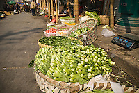 Basket of greens for sale in street market, Shanghai, China