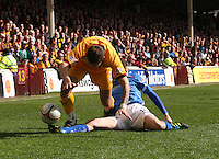 David Robertson tackles Tom Hateley in the Motherwell v St Johnstone Clydesdale Bank Scottish Premier League match played at Fir Park, Motherwell on 28.4.12.