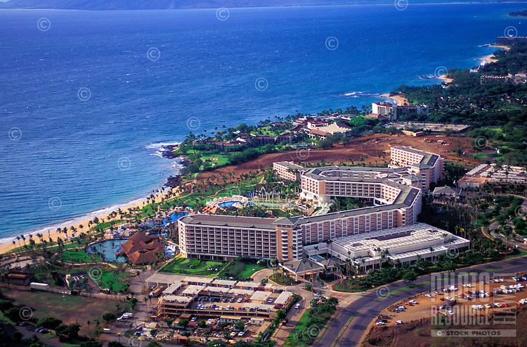 Aerial view of the Grand Wailea resort spreading along the Maui coast