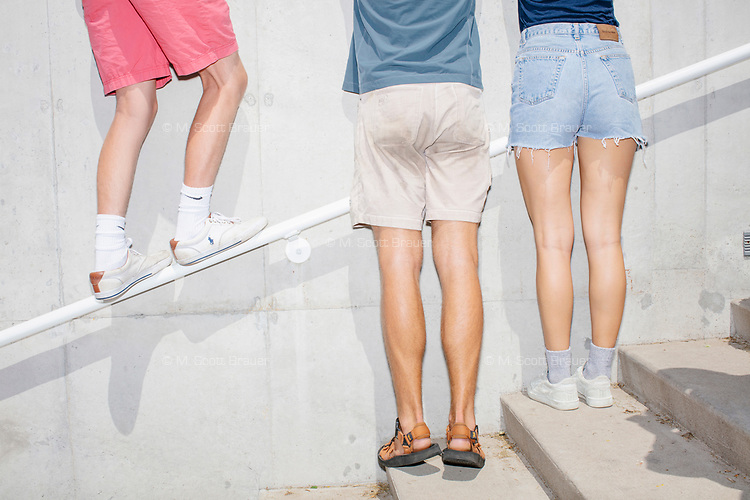People stand on a staircase railing to catch a glimpse as South Bend mayor and Democratic presidential candidate Pete Buttigieg speaks at the Political Soapbox at the Iowa State Fair in Des Moines, Iowa, on Tues., Aug. 13, 2019.