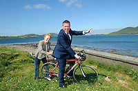 REPRO FREE: 20-6-2014: &euro;3.4m greenway for South Kerry.<br /> Mary o'Connor from Waterville gives her son-in-law, Junior Transport Minister Alan Kelly a friendly push off after he turned the first sod for Phase 1 of the South Kerry Greenway project at Mannix Point, Cahersiveen, County Kerry on Friday surrounded by members of Kerry County Council, ACARD and local politicians.<br /> The South Kerry Greenway will facilitate walkers and cyclists and stretch 26 kilometres from Glenbeigh to Caherciveen and Renard and will be routed along the old railway line. The route includes travelling through train tunnels, crossing over the magnificient Gleesk Viaduct all along the Wild Atlantic Way with the most spectacular scenery in Ireland overlooking Dingle Bay.<br /> Picture by Don MacMonagle<br /> <br /> FREE REPRO