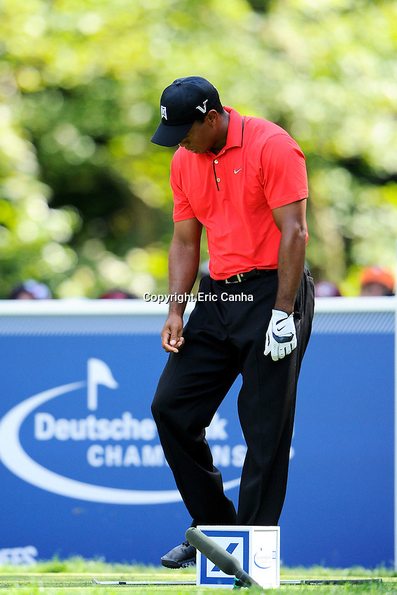 September 3, 2012 Tiger Woods of the United States reacts to his tee shot on the 8th hole during the championship round of the Deutsche Bank Championship tournament held at The Tournament Players Club, in Norton, Massachusetts.  Eric Canha/CSM