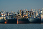 Old rusting war ships tied up and at anchor in the (Mothball) Naval Reserve Defense Fleet in Suisun Bay, California