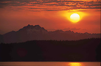 Sun setting by Brothers Mountain, Olympic Mountains, Puget Sound, Washington State
