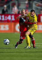 23 April 2011: Columbus Crew midfielder Dejan Rusmir #22 and Toronto FC defender Mikael Yourassowsky #19 in action during a game between the Columbus Crew and the Toronto FC at BMO Field in Toronto, Ontario Canada..The game ended in a 1-1 draw.