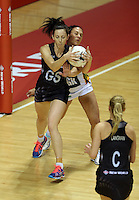 28.07.2015 Silver Ferns Bailey Mes and South Africa's Adele Niemand in action during the Silver Fern v South Africa netball test match played at Trusts Arena in Auckland. Mandatory Photo Credit ©Michael Bradley.