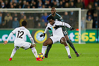 Wilfried Bony of Swansea City protects the ball from Eliaquim Mangala of Manchester City during the EPL - Premier League match between Swansea City and Manchester City at the Liberty Stadium, Swansea, Wales on 13 December 2017. Photo by Mark  Hawkins / PRiME Media Images.