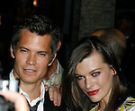 "HOLLYWOOD, CA. - August 05: Milla Jovovich and Timothy Olyphant arrive at the premiere of ""A Perfect Getaway"" at the Cinerama Dome on August 5, 2009 in Hollywood, California."
