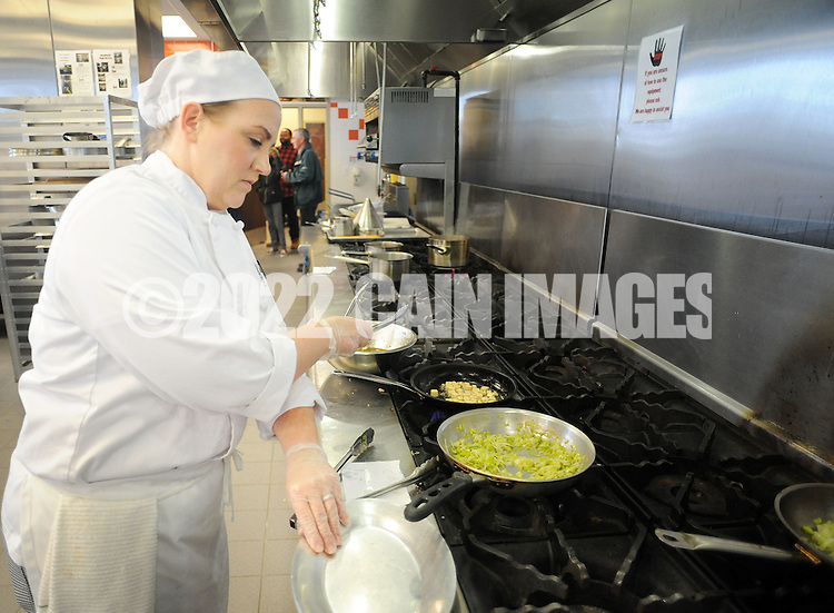 Gretchen Sinclair works on her dish at the grill as she competes in the final round of the Culinary Arts Institute of Montgomery County Community College Student Iron Chef Competition during Open House Saturday April 16, 2016 at Culinary Arts Institute in Towamencin, Pennsylvania. (Photo by William Thomas Cain)