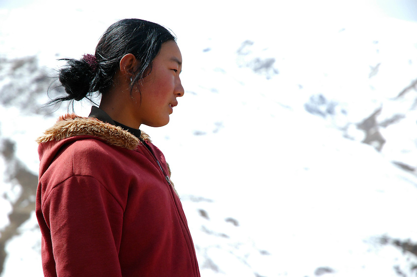 A girl taking a break from gathering stones in the hills around Ganzi - taken March 18, 2008 - Michael Benanav - 505-579-4046