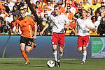 14 JUN 2010: Thomas Kahlenberg (DEN) (12) is followed by Joris Mathijsen (NED) (4). The Netherlands National Team defeated the Denmark National Team 2-0 at Soccer City Stadium in Johannesburg, South Africa in a 2010 FIFA World Cup Group E match.