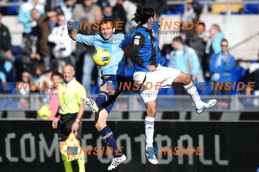 Senad Lulic Lazio, Ezequiel Schelotto Atalanta.Roma 15/01/2012 Stadio Olimpico.Football Calcio 2011/2012 Serie A.LAzio Vs Atalanta.Foto Insidefoto Andrea Staccioli