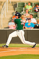John Schultz #35 of the Greensboro Grasshoppers follows through on his swing against the Kannapolis Intimidators at CMC-Northeast Stadium on July 4, 2012 in Kannapolis, North Carolina.  The Intimidators defeated the Grasshoppers 6-1.  (Brian Westerholt/Four Seam Images)