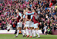 Chris Wood is mobbed by team-mates as he and Dwight McNeil (right) celebrate scoring their sides second goal <br /> <br /> Photographer Rich Linley/CameraSport<br /> <br /> The Premier League - Saturday 13th April 2019 - Burnley v Cardiff City - Turf Moor - Burnley<br /> <br /> World Copyright © 2019 CameraSport. All rights reserved. 43 Linden Ave. Countesthorpe. Leicester. England. LE8 5PG - Tel: +44 (0) 116 277 4147 - admin@camerasport.com - www.camerasport.com