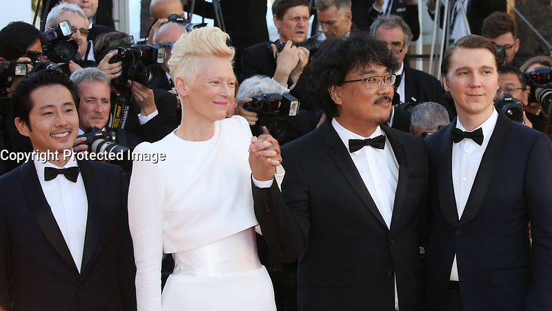 STEVEN YEUN, TILDA SWINTON, DIRECTOR BONG JOON-HO AND PAUL DANO - RED CARPET OF THE FILM 'OKJA' AT THE 70TH FESTIVAL OF CANNES 2017