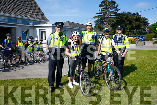 Community Garda Seamus Moriarty with  Colleagues Garda Mike Dwyer and Garda Merlyn O'Connor were helping 5th and 6th Class students from Spa National School with Cycle Safety on Monday. Pictured Garda Mike Dwyer, Eric Borowy, Community Garda Seamus Moriarty, Isabel Ryan and Garda Merlyn O'Connor with 5th & 6th Classes