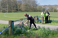 Pictured: A young man leaves flowers at Ystrad Mynach Park in south Wales, UK. Saturday 13 April 2019<br /> Re: A 13-year-old boy, named locally as Carson Price,  has died after being found unconscious in Ystrad Mynach Park, Caerphilly County, at about 7.20pm on Friday 12 April.<br /> The teen was taken to University Hospital of Wales in Cardiff where he was pronounced dead.