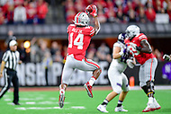 Indianapolis, IN - DEC 1, 2018: Ohio State Buckeyes wide receiver K.J. Hill (14) moves the chains with a catch over the middle during second half action of the Big Ten Championship game between Northwestern and Ohio State at Lucas Oil Stadium in Indianapolis, IN. Ohio State defeated Northwestern 45-24. (Photo by Phillip Peters/Media Images International)