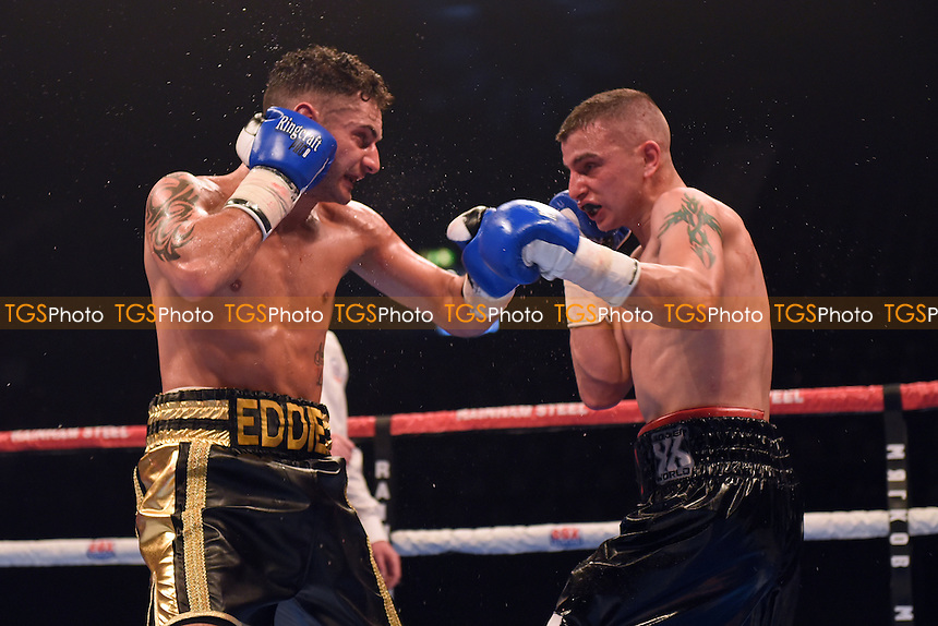Ediz Hussein (black/gold shorts) defeats Alex Phillips during a Boxing Show at Wembley Arena, London, England, promoted by Frank Warren on 26/09/2015