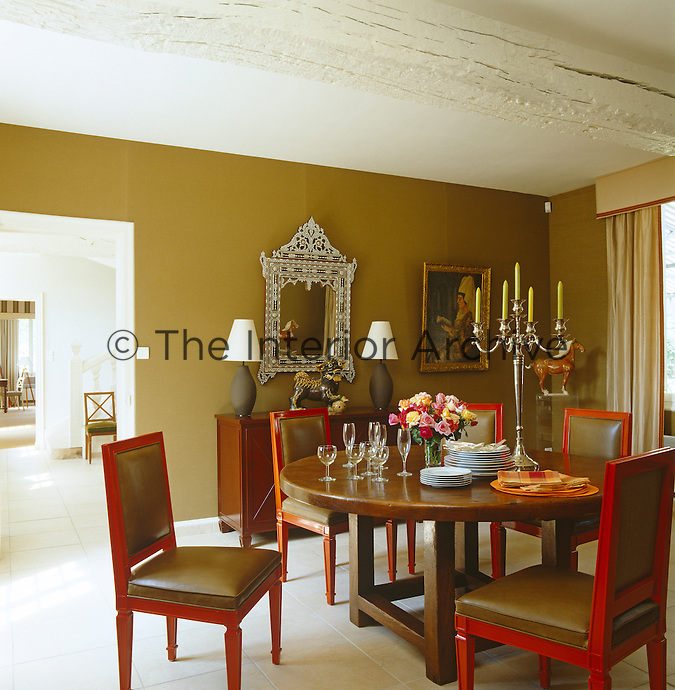 A 16th century French table is teamed with a Napoleon sideboard designed by Todd Hase in this elegant dining room