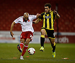 Alex Baptiste of Sheffield Utd tussles with Mason Bennett of Burton Albion - English League One - Sheffield Utd vs Burton Albion - Bramall Lane Stadium - Sheffield - England - 1st March 2016 - Pic Simon Bellis/Sportimage