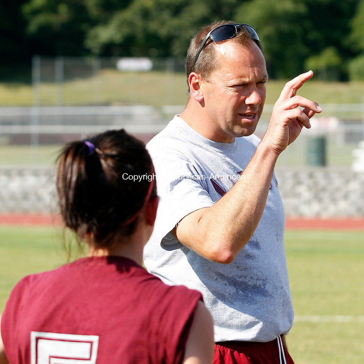 Naugatuck, CT- 07, September 2010-090710CM01  Jose Sendra, head coach of Naugatuck High School girls soccer team, instructs his team during practice Tuesday afternoon at Naugatuck High School.  The girls soccer team welcomes two new assistant coaches to the line-up this year, Sean Dunn and Dave Ciskowski.  The Greyhounds open their 2010 season against Holy Cross, September 14, at 6:30pm at Municipal Stadium in Waterbury.  Christopher Massa Republican-American