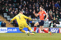 Danny Hylton of Luton Town rounds keeper Artur Krysiak to score his and his sides second goal of the game during the Sky Bet League 2 match between Yeovil Town and Luton Town at Huish Park, Yeovil, England on 4 March 2017. Photo by Liam Smith / PRiME Media Images.