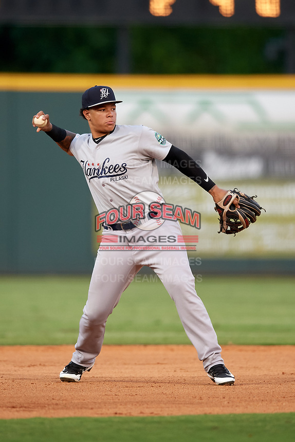 Pulaski Yankees third baseman Nelson Gomez (14) throws to first base during a game against the Greeneville Reds on July 27, 2018 at Pioneer Park in Tusculum, Tennessee.  Greeneville defeated Pulaski 3-2.  (Mike Janes/Four Seam Images)