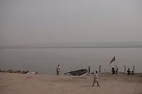 Indian men on a ghat in Varanasi, Uttar Pradesh, India.
