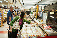 Shoppers at the sushi department at Mitsuwa asian market during their Obon summer festival in Edgewater, NJ on Saturday. August 18, 2012. The supermarket chain of nine stores located across the country sells Japanese food and goods.  The company holds a yearly summer festival inviting customers to their facilities to enjoy traditional food and partake of the many sales offered on their merchandise. (© Richard B. Levine)