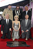 HOLLYWOOD, CA - JANUARY 8: Joel McHale, councilmember Mitch O'Farrell, Gillian Anderson, Bryan Fuller, Leron Gubler, at Gillian Anderson Honored With Star On The Hollywood Walk Of Fame at On The Hollywood Walk Of Fame in Hollywood, California on January 8, 2018. <br /> CAP/MPI/FS<br /> &copy;FS/MPI/Capital Pictures