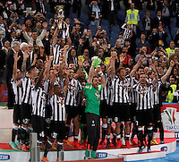 Calcio, finale Tim Cup: Juventus vs Lazio. Roma, stadio Olimpico, 20 maggio 2015.<br /> Juventus' Giorgio Chiellini, top, holds up the trophy at the end of the Italian Cup final football match between Juventus and Lazio at Rome's Olympic stadium, 20 May 2015. Juventus won 2-1 after extra time.<br /> UPDATE IMAGES PRESS/Isabella Bonotto