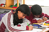 Arequipa, Peru. Hefziba, a parochial (Christian), private school for elementary and secondary school students. Students (middle-school age, Peruvian) work on schoolwork in class. No MR. ID: AL-peru.