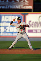 New Britain Rock Cats second baseman Joey Wong (21) throws to first during a game against the Reading Fightin Phils on August 7, 2015 at FirstEnergy Stadium in Reading, Pennsylvania.  Reading defeated New Britain 4-3 in ten innings.  (Mike Janes/Four Seam Images)