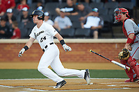 Chris Lanzilli (24) of the Wake Forest Demon Deacons drops his bat as he starts down the first base line during the game against the North Carolina State Wolfpack at David F. Couch Ballpark on April 18, 2019 in  Winston-Salem, North Carolina. The Demon Deacons defeated the Wolfpack 7-3. (Brian Westerholt/Four Seam Images)