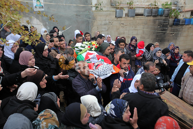Palestinian mourners carry the body of Samah Abd al-Mumen, 19, during her funeral in the West Bank city of Nablus, on December 17, 2015. Samah died on Wednesday at Benlson Hospital from wounds she had sustained nearly two months previously, when she was caught in Israeli crossfire during a stabbing incident at Huwarra Checkpoint. Photo by Nedal Eshtayah
