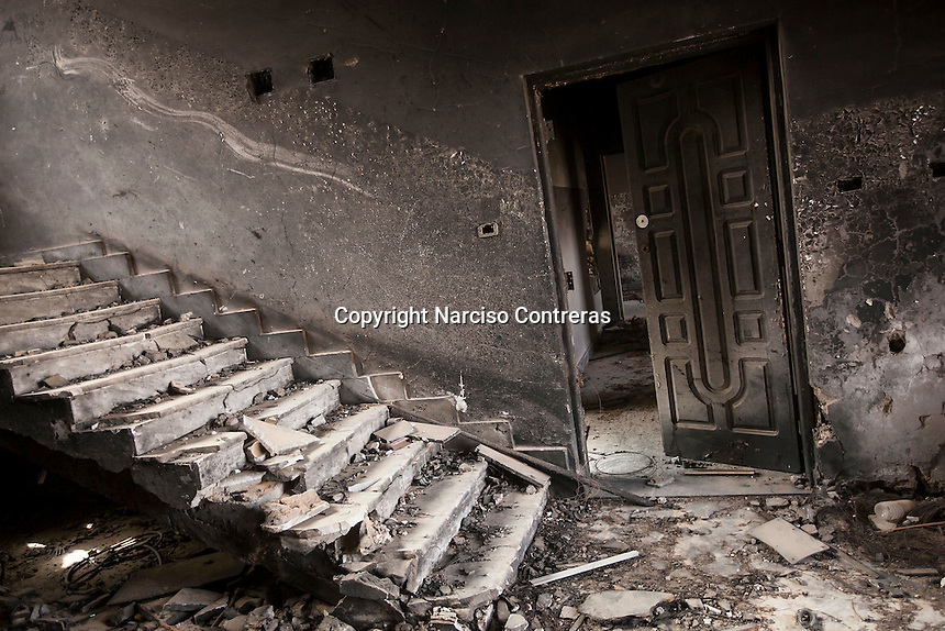 November 12, 2014 - Tawergha City, Libya: A burned apartment is seen in Tawergha City ghost town after heavy clashes occured during 2011 war in Libya when Tawerghans were forced to move from their city home as they were harassed by the armed militias of Misrata during the uprising against Colonel Gaddafi. (Photo/Narciso Contreras)
