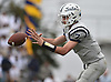 Charlie McKee #7, Oceanside freshman quarterback, takes a snap during a Nassau County Conference I varsity football game against host Baldwin High School on Saturday, Oct. 6, 2018. Oceanside won by a score of 35-0.