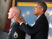 United States President Barack Obama awards the Medal of Honor for conspicuous gallantry to Staff Sergeant Ty M. Carter, U.S. Army, during a ceremony in the East Room of the White House in Washington, D.C. on Monday, August 26, 2013.  Staff Sergeant Carter is being honored for courageous actions while serving as a cavalry scout with Bravo Troop, 3rd Squadron, 61st Cavalry Regiment, 4th Brigade Combat Team, 4th Infantry Division, during combat operations in Kamdesh District, Nuristan Province, Afghanistan on October 3, 2009. Staff Sergeant Carter is the fifth living veteran to be awarded the Medal of Honor for actions in Iraq or Afghanistan.  <br /> Credit: Ron Sachs / CNP