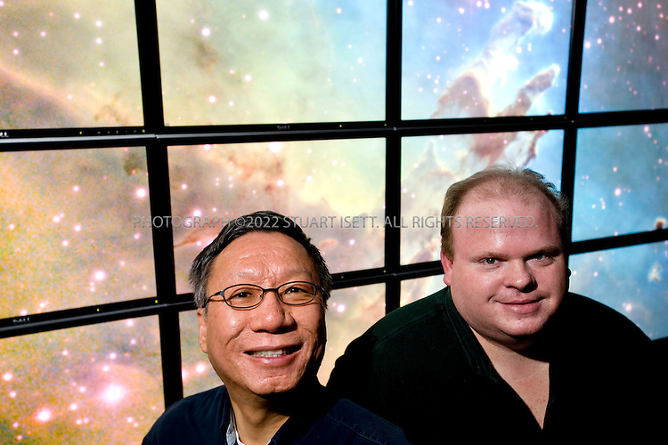 5/7/2008--Redmond, WA, USA..Left: Curtis Wong, principle researcher, Next Media Research at Microsoft. Right: Jonathan Fay, principle research software design engineer, Next Media Research at Microsoft...Wong and Curtis are posing in front of images from Microsoft's new website WorldWideTelescope.org, that allows a person to take a multimedia tour of the universe with data is fed from different space telescopes...©2008 Stuart Isett. All rights reserved.