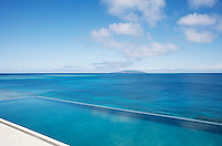 The azure water of the infinity pool blends with the waters of the Koro Sea beyond