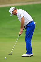 Graeme McDowell (NIR) putts on the 1st green during Saturay's Round 3 of the 2014 BMW Masters held at Lake Malaren, Shanghai, China. 1st November 2014.<br /> Picture: Eoin Clarke www.golffile.ie